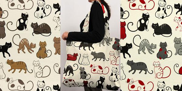 Dekorativní látka s motivem koček.