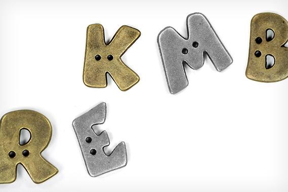Metallic-look alphabet buttons