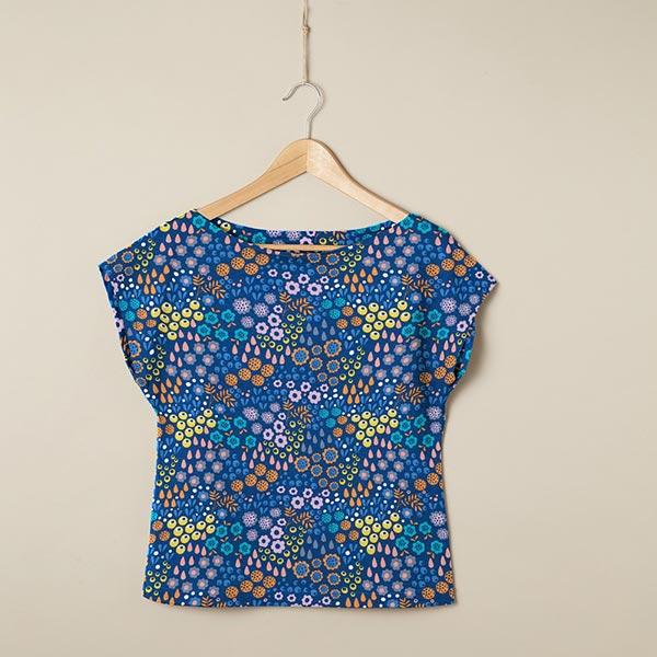 Jersey coton Fleurs sur la prairie   Coppenrath – bleu roi/jaune orangé
