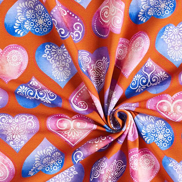 Baumwolljersey Mandala-Herzen – terracotta/lila