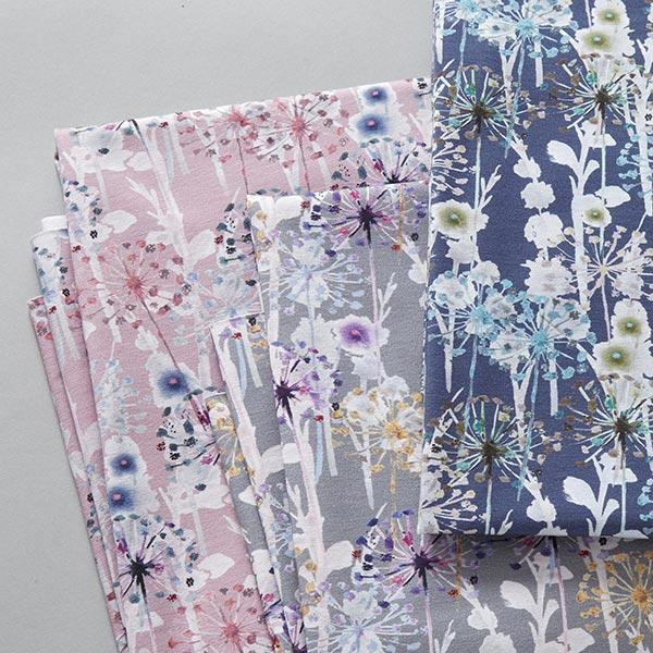 Jersey coton Fleurs de pissenlit aspect batik – lilas pastel