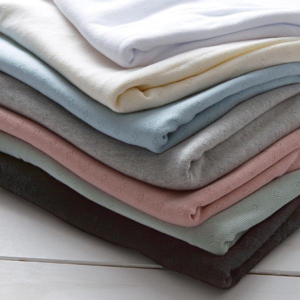 Jersey finement tricoté à motif ajouré – vieux rose