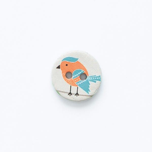 Bouton motif oiseau 2trous [ Ø 15 mm ] – écru/orange